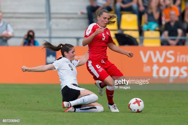 Sarah Zadrazil of Austria and Noelle Maritz of Switzerland battle for the ball during the Group C match between Austria and Switzerland during the...