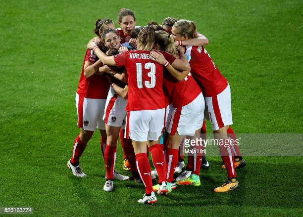 Sarah Zadrazil of Austria celebrate with her team mates after she scores the opening goal during the Group C match between Iceland and Austria during...