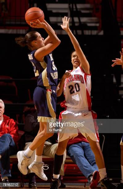 SarahJo Lawrence of the George Washington Colonials takes a jump shot over Kristi Toliver of the Maryland Terrapins November 19 2006 at Comcast...