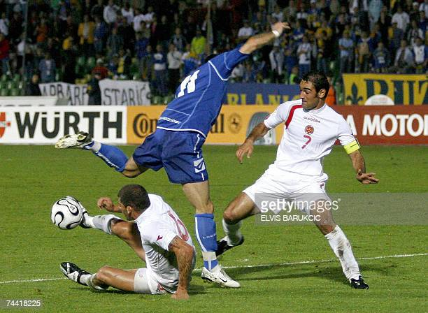 Darko Maletic of Bosnia and Herzegovina vies with Luke Dimech and Gilbert Agius of Malta during their EURO 2008 qualifier match in Sarajevo 06 June...