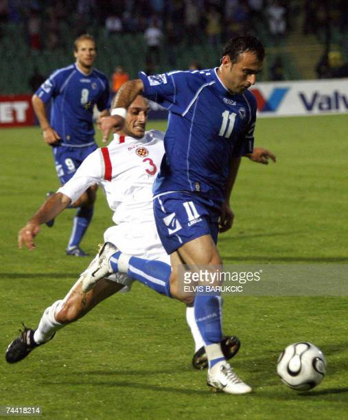 Duel of Darko Maletic of Bosnia and Herzegovina and Ian Azzopardi of Malta vie for the ball during their EURO 2008 qualifier match in Sarajevo 06...