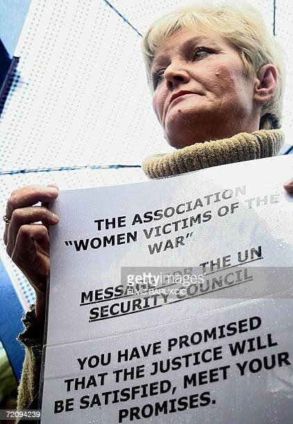 Some 40 Bosnian Muslim women protest outside the UN war crimes tribunal in Sarajevo 05 October 2006 urging it to charge Serb paramilitary chief Milan...