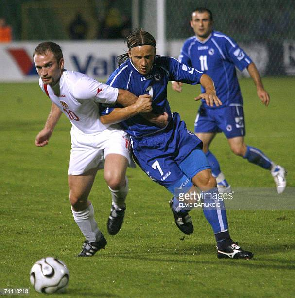 Vedin Music of Bosnia and Herzegovina vies for the ball with Ivan Woods of Malta during their EURO 2008 qualifier match in Sarajevo 06 June 2007 AFP...