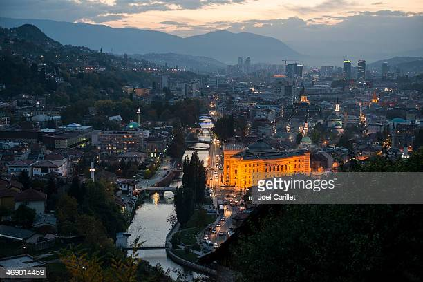 sarajevo cityscape and national library at dusk - sarajevo stock pictures, royalty-free photos & images