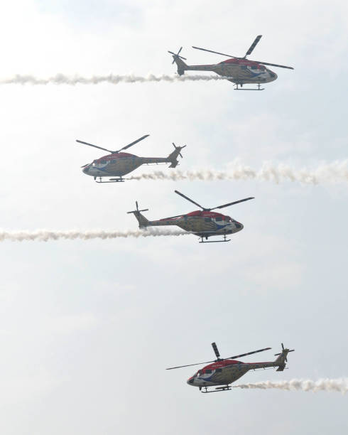 Sarang helicopter during aerobatic display at Adampur air force station on November 16 2017 near Jalandhar India President Ram Nath Kovind awarded...