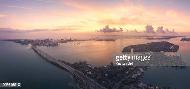 sarasota city, bridge and bird key at dawn with fog - sarasota stock photos and pictures
