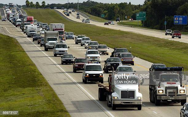 Rushhour commuters mix with voluntary evacuees creating heavy traffic on the northbound I75 20 October in Sarasota Florida as officials issued...
