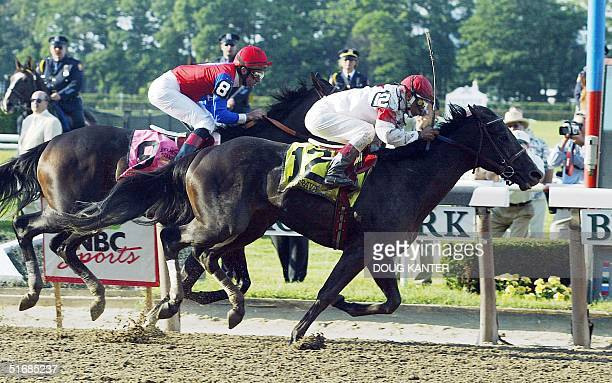 Sarava with jockey Edgar Prado aboard crosses the finish line ahead of Medaglia d'Oro to win the 134th Belmont Stakes 08 June in Elmont NY Triple...