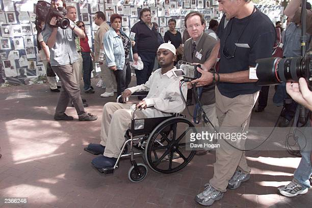 Saravan Rangaswamy and wife Priya leave Bellevue Hospital in New York on 9/17/2001 after he escaped the collapse He was starting his first day of...