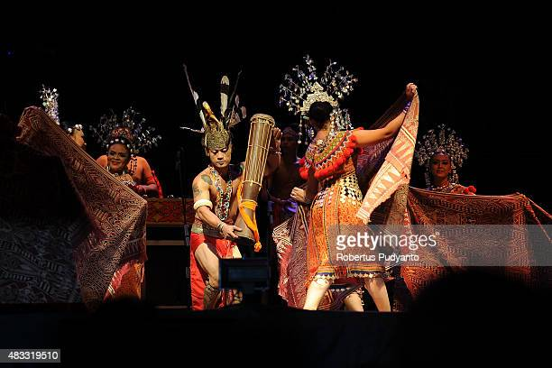 Sarawak Cultural Village Iban Folk Song and Miring Dancers perform during opening ceremony of Rainforest World Music Festival 2015 at Sarawak...