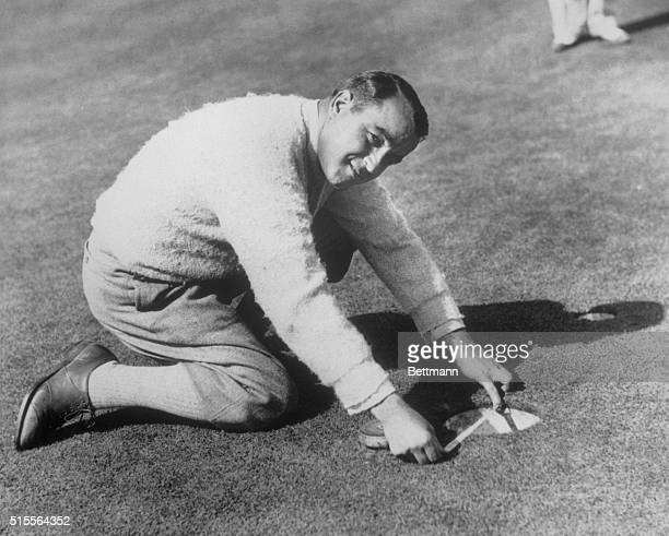 Sarazen Demonstrates 8Inch Cup Gene Sarazen American and British Open Golf Champion who wants to put a new thrill in golf by expanding the cup from 4...