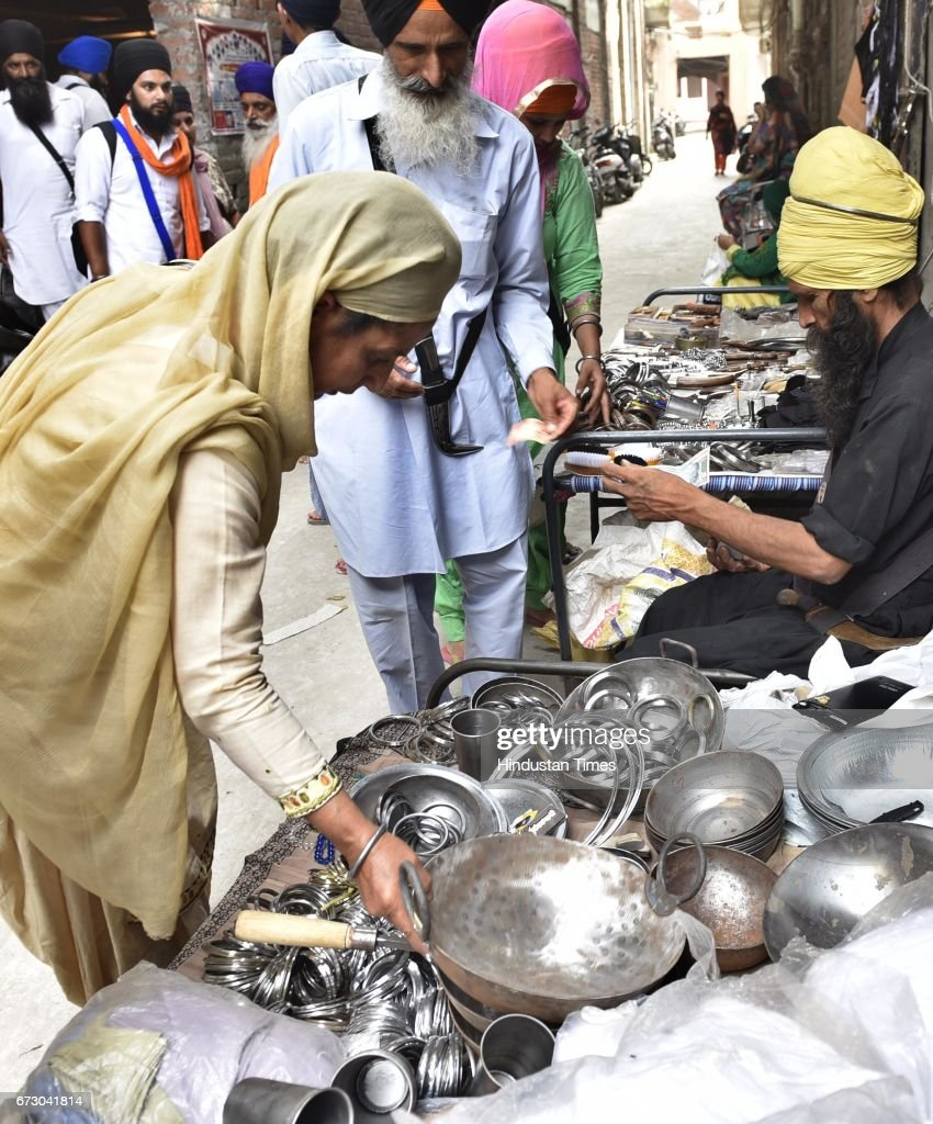 Sarbloh Utensils sold by local venders outside the Rangla Sahib on April 25 2017 in Amritsar India Sarbloh is the metal used in the Bata used by Guru.