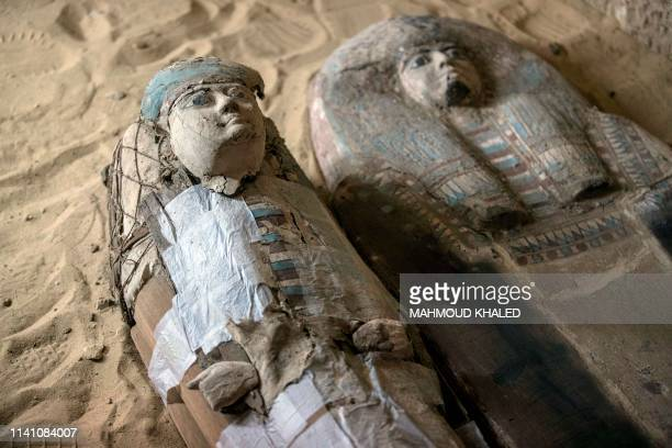 Sarcophagi are seen inside a burial shaft at the Giza pyramid plateau on the southwestern outskirts of the Egyptian capital Cairo on May 4 following...
