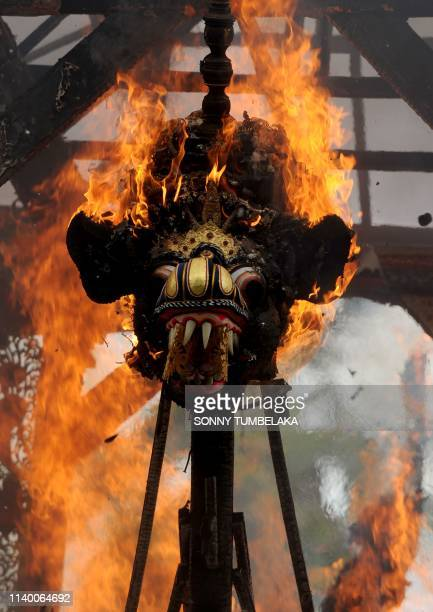 A sarcophagus is burned during the cremation of two late family members of Indonesian national hero I Gusti Ngurah Rai in the village of Carangsari...