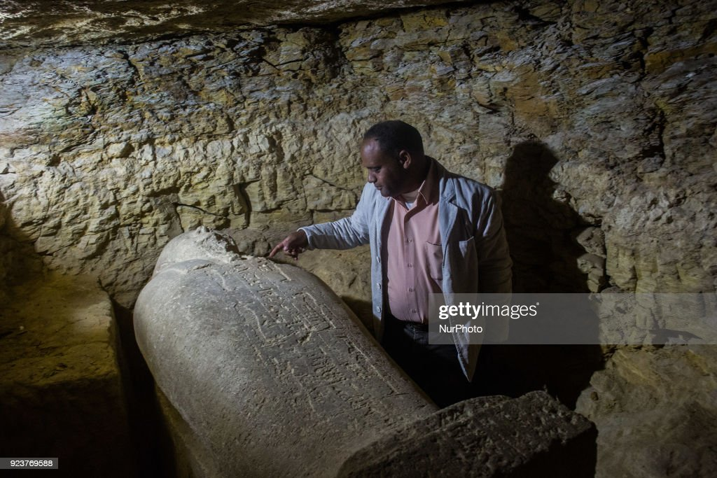 A sarcophagus that was discovered is displayed at the site of an ancient Egyptian cemetery, in Minya province, 245 km south of Cairo, Egypt, 24 February 2018. According to the Ministry of Antiquities, an ancient Egyptian cemetery was discovered six kilometers north of Tuna al-Gabal archaeological site in Minya, containing a number of burial shafts dating to the late pharaonic period and early Ptolemaic era. The archaeological mission unearthed a mummy decorated with a bronze collar, 1000 figurines, some 40 sarcophagi, four canopic jars, and other funerary items.