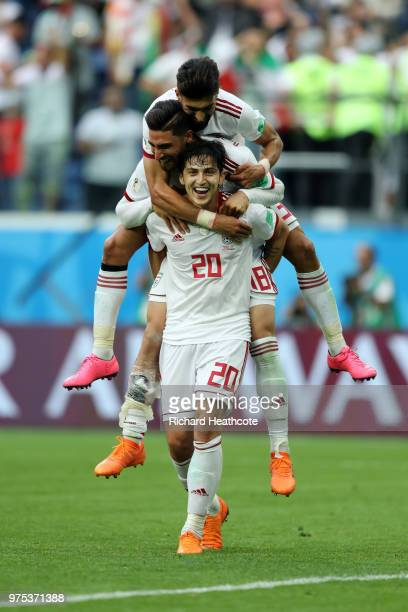 Sardar Azmoun Alireza Jahanbakhsh and Ramin Rezaeian of Iran celerate victory at the end of the 2018 FIFA World Cup Russia group B match between...
