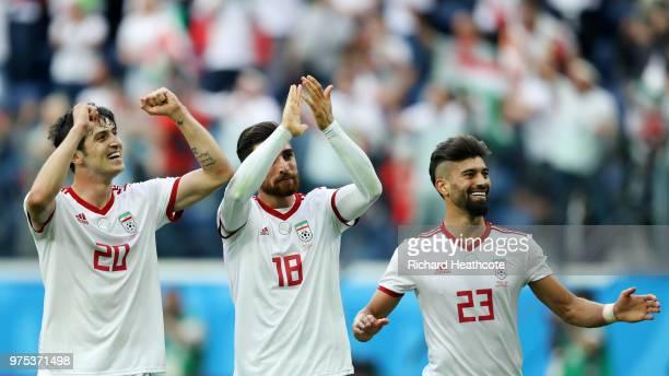 Sardar Azmoun Alireza Jahanbakhsh and Ramin Rezaeian of Iran celebrate their side's win following the 2018 FIFA World Cup Russia group B match...