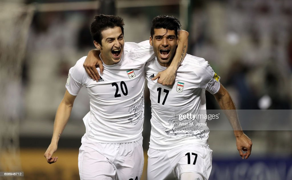 Sardar Azmoun (L) and Mehdi Taremi of Iran celebrate after first goal during Qatar against Iran - FIFA 2018 World Cup Qualifier on March 23, 2017 in Doha, Qatar.