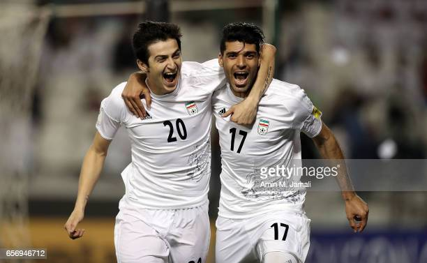 Sardar Azmoun and Mehdi Taremi of Iran celebrate after first goal during Qatar against Iran FIFA 2018 World Cup Qualifier on March 23 2017 in Doha...