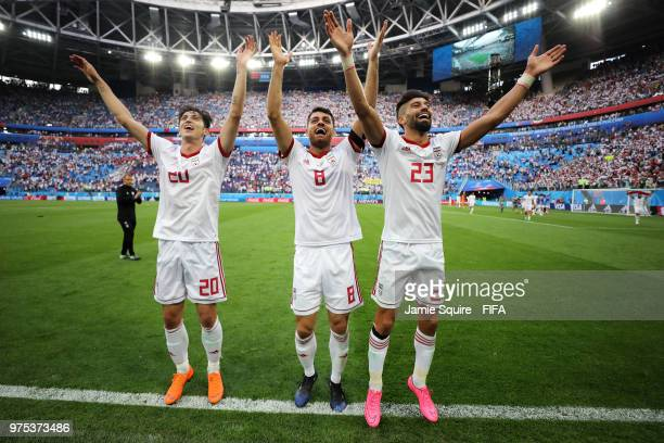 Sardar Azmoun, Morteza Pouraliganji and Ramin Rezaeian of Iran celebrate victory after the 2018 FIFA World Cup Russia group B match between Morocco...