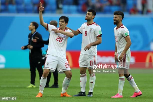 Sardar Azmoun Morteza Pouraliganji and Ramin Rezaeian of Iran celebrate their side's win following the 2018 FIFA World Cup Russia group B match...