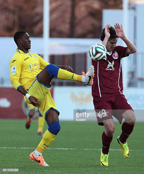 Sardar Azmoun of FC Rubin Kazan is challenged by Bastos of FC Rostov Rostov-on-Don during the Russian Football League Championship match between FC...