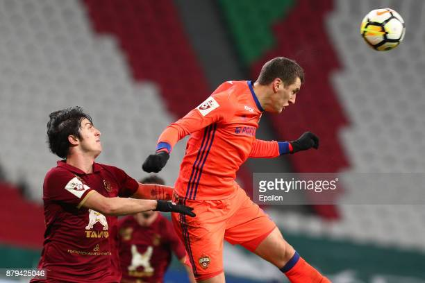 Sardar Azmoun of FC Rubin Kazan vies for the ball with Viktor Vasin PFC CSKA Moscow during the Russian Premier League match between FC Rubin Kazan...