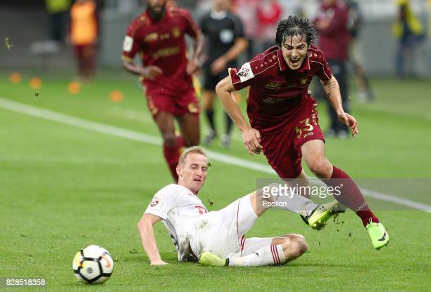 Sardar Azmoun of FC Rubin Kazan vies for the ball with Vladislav Ignatyev FC Lokomotiv Moscow during the Russian Premier League match between FC...
