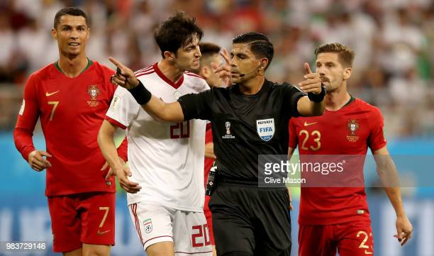 Sardar Azmoun of Iran agrues with Referee Enrique Caceres as Cristiano Ronaldo of Portugal looks on during the 2018 FIFA World Cup Russia group B...