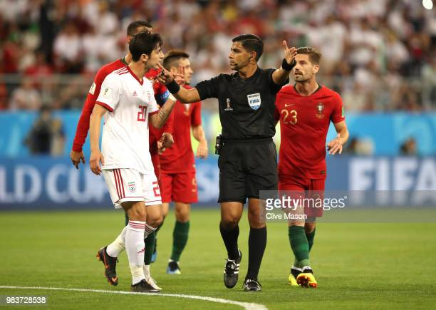 Sardar Azmoun of Iran agrues with Referee Enrique Caceres during the 2018 FIFA World Cup Russia group B match between Iran and Portugal at Mordovia...