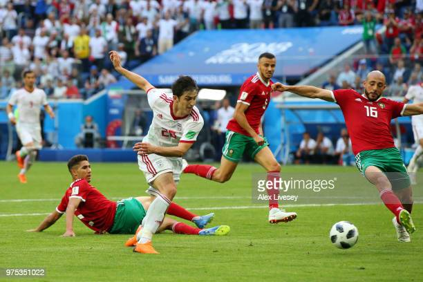 Sardar Azmoun of Iran and Noureddine Amrabat of Morocco race to the ball during the 2018 FIFA World Cup Russia group B match between Morocco and Iran...