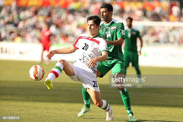Sardar Azmoun of Iran and Salam Shakir of Iraq contest possession during the 2015 Asian Cup match between Iran and Iraq at Canberra Stadium on...