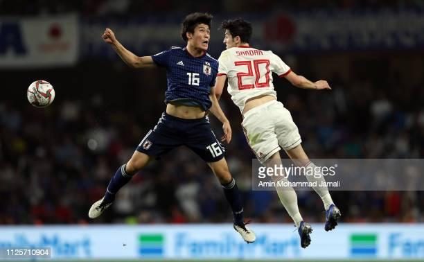 Sardar Azmoun of Iran and Tomiyaso Takehiro of Japan in action during the AFC Asian Cup semi final match between Iran and Japan at Hazza Bin Zayed...