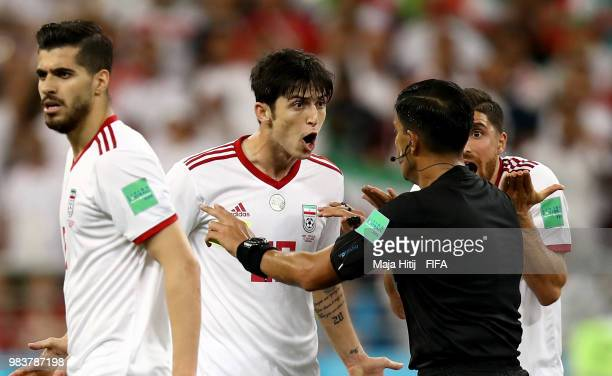Sardar Azmoun of Iran arfiues with Referee Enrique Caceres during the 2018 FIFA World Cup Russia group B match between Iran and Portugal at Mordovia...