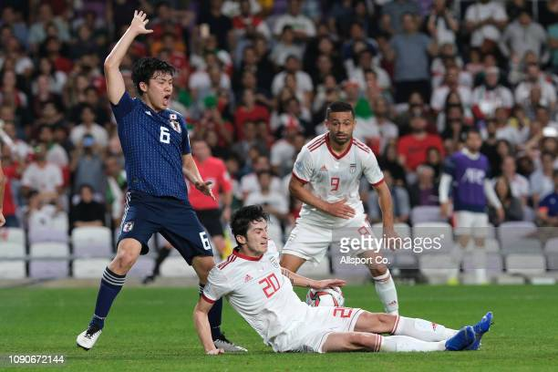 Sardar Azmoun of Iran battles Wataru Endo of Japan during the AFC Asian Cup semi final match between Iran and Japan at Hazza Bin Zayed Stadium on...