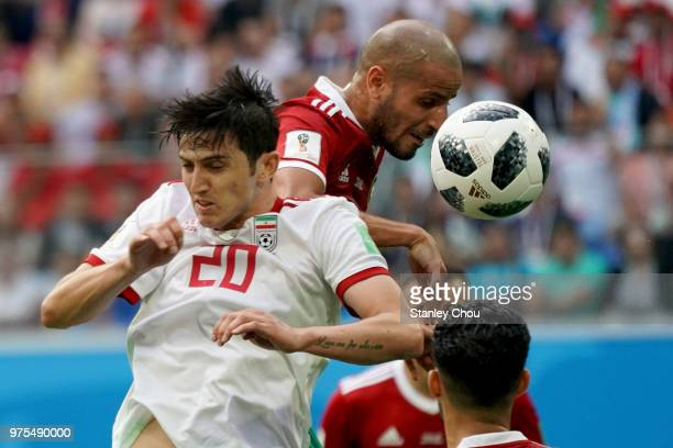 Sardar Azmoun of Iran battles with Noureddine Amrabat of Morocco during the 2018 FIFA World Cup Russia group B match between Morocco and Iran at...