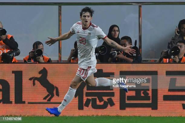 Sardar Azmoun of Iran celebrates after scorering his team's second goal during the AFC Asian Cup quarter final match between China and Iran at...