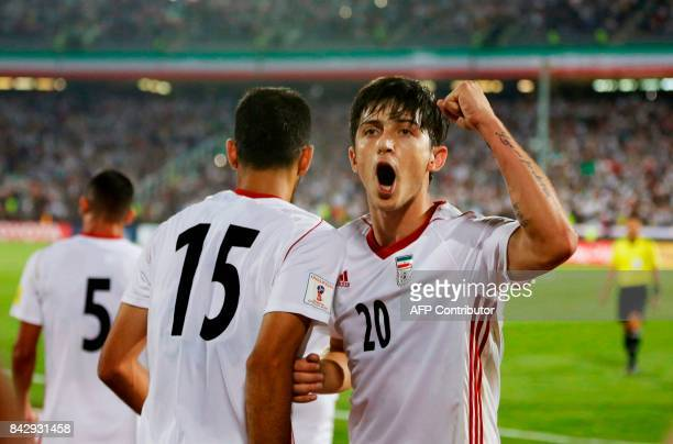 Sardar Azmoun of Iran celebrates after scoring a goal against Syria during the FIFA World Cup 2018 qualification football match between Iran and...