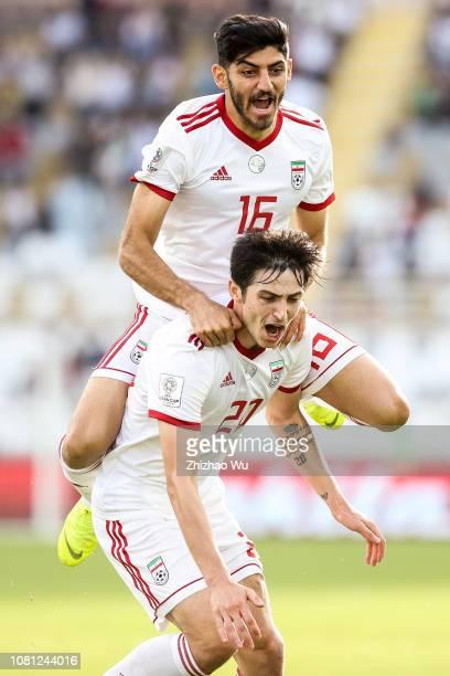 Sardar Azmoun of Iran celebrates his scoring with teammates during the AFC Asian Cup Group D match between Vietnam and Iran at Al Nahyan Stadium on...