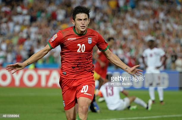 Sardar Azmoun of Iran celebrates scoring the opening goal against Qatar in their Group C football match in the AFC Asian Cup in Sydney on January 15...