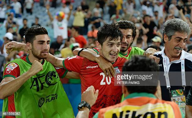 Sardar Azmoun of Iran celebrates scoring the opening goal with teammates against Qatar in their Group C football match in the AFC Asian Cup in Sydney...