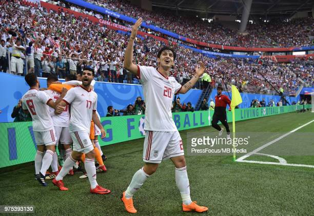 Sardar Azmoun of Iran celebrates their first goal with team mates during the 2018 FIFA World Cup Russia group B match between Morocco and Iran at...