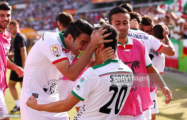 Sardar Azmoun of Iran celebrates with team mates after scoring a goal during the 2015 Asian Cup match between Iran and Iraq at Canberra Stadium on...
