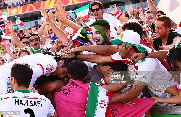 Sardar Azmoun of Iran celebrates with team mates and fans after scoring a goal during the 2015 Asian Cup match between Iran and Iraq at Canberra...
