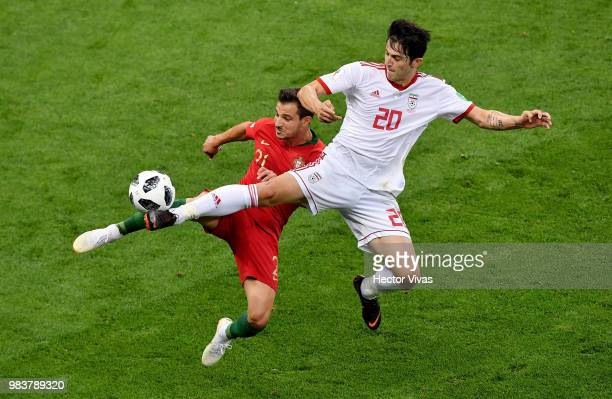Sardar Azmoun of Iran challenge for the ball with Cedric of Portugal during the 2018 FIFA World Cup Russia group B match between Iran and Portugal at...