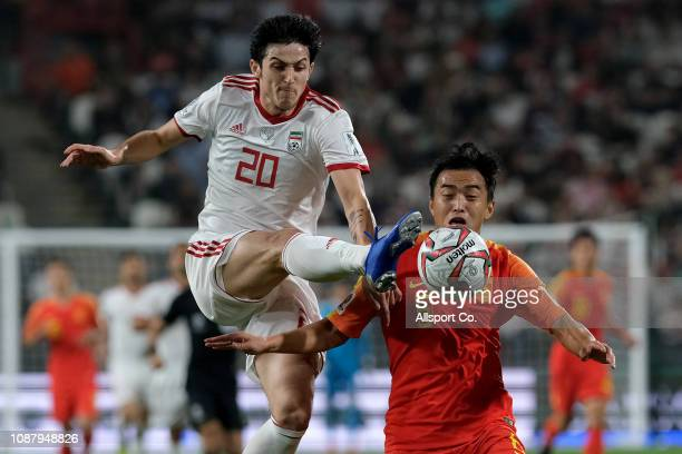 Sardar Azmoun of Iran challenges Feng Xiaoting of China during the AFC Asian Cup quarter final match between China and Iran at Mohammed Bin Zayed...
