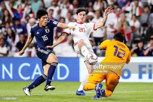 Sardar Azmoun of Iran competes with Tomiyasu Takehiro of Japan during the AFC Asian Cup semi final match between Iran and Japan at Hazza Bin Zayed...