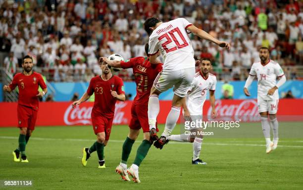 Sardar Azmoun of Iran heads the ball on Cedric of Portugal's arm to gain a penalty during the 2018 FIFA World Cup Russia group B match between Iran...