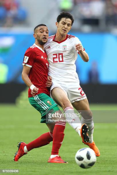 Sardar Azmoun of Iran is challenged by Hakim Ziyach of Morocco during the 2018 FIFA World Cup Russia group B match between Morocco and Iran at Saint...