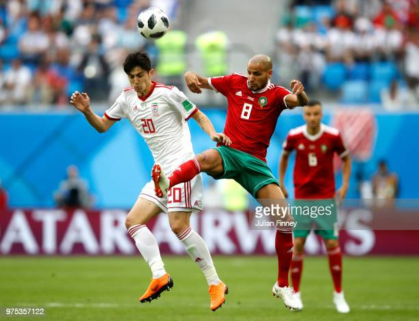 Sardar Azmoun of Iran is challenged by Karim El Ahmadi of Morocco during the 2018 FIFA World Cup Russia group B match between Morocco and Iran at...